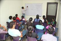 Teacher explaining students